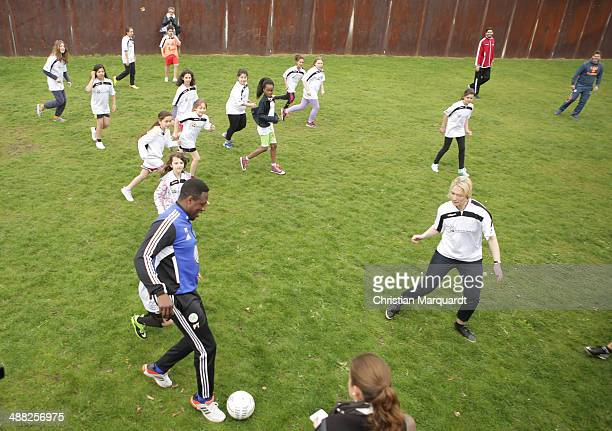 German Family Minister Manuela Schwesig and Pablo Thiam join a football match with children from the 'Kinder von der Strasse e.V.' association on May...