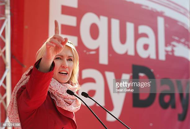 German Family Minister Manuela Schwesig speaks to men and women rallying for equal pay for women compared to men on Equal Pay Day on March 20, 2015...
