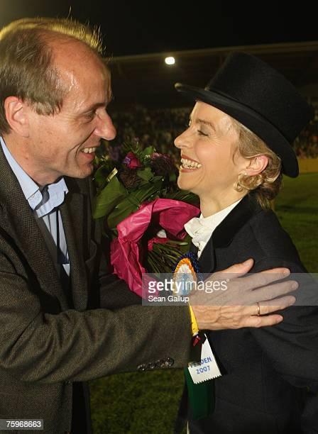German Family Minister Ursula von der Leyen is greeted by her husband Heiko von der Leyen after peforming her dressage skills with Hannoverer horse...