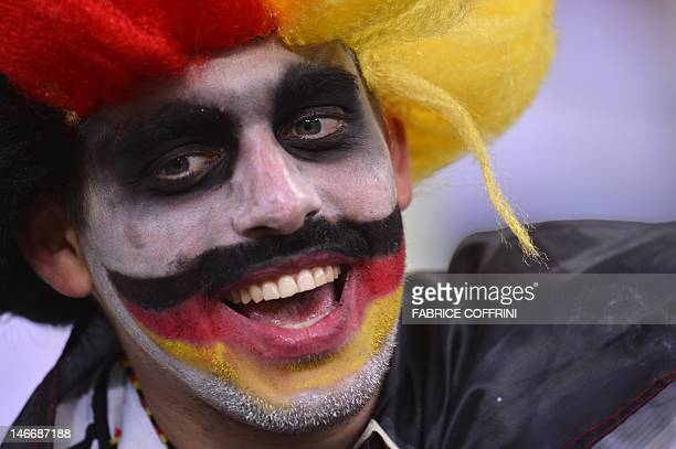 A German fan cheers before the Euro 2012 football championships quarterfinal match Germany vs Greece on June 22 2012 at the Gdansk Arena AFP PHOTO /...