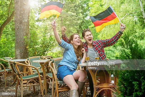 German Fan Couple Supporting Soccer Team in Beer Garden