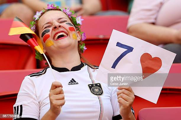 German fan laughs during the Women's First Round Group F match between Germany and Canada on Day 4 of the Rio 2016 Olympic Games at Mane Garrincha...