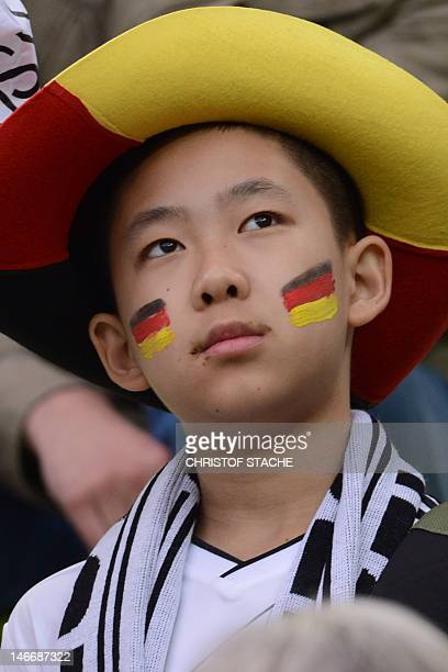 A German fan poses prior to the Euro 2012 football championships quarterfinal match Germany vs Greece on June 22 2012 at the Gdansk Arena AFP PHOTO /...