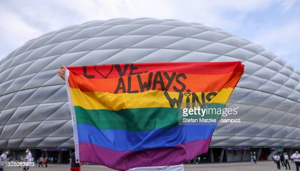 German fan poses with a rainbow flag in front of the Munich Stadium before the UEFA Euro 2020 Championship Group F match between Germany and Hungary...
