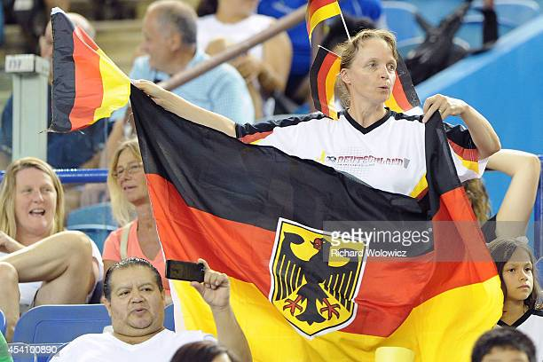 German fan waves the national flag prior to the FIFA Women's U20 Final between Germany and Nigeria at Olympic Stadium on August 24 2014 in Montreal...