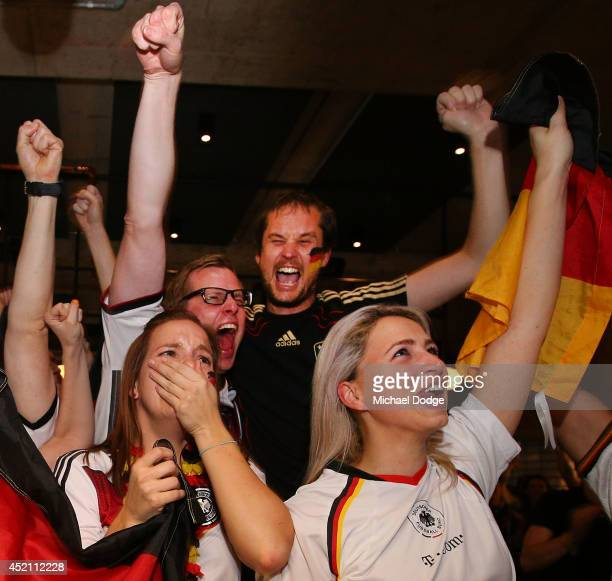 German fans at Hophaus celebrate the win as the cup gets lifted while watching the 2014 FIFA World Cup Final match between Germany and Argentina on...
