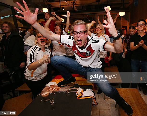 German fans at Hophaus celebrate the winning goal while watching the 2014 FIFA World Cup Final match between Germany and Argentina on July 14 2014 in...