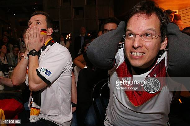 German fans at Hophaus react after conceding a goal that was later ruled offside while watching the 2014 FIFA World Cup Final match between Germany...