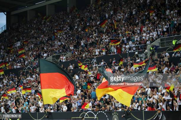 German fans celebrate during the UEFA Euro 2020 Qualifier match between Germany and Estonia at Opel Arena on June 11 2019 in Mainz Germany