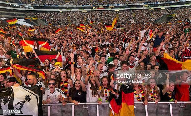 German fans celebrate their team's victory while watching on a giant screen GermanyFrance quarterfinals soccer match for the 2014 World Cup at the...