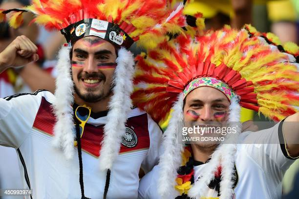 German fans cheer for their team before the start of the Group G football match between Germany and Ghana at the Castelao Stadium in Fortaleza during...