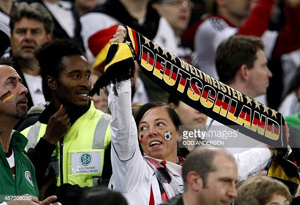 German fans cheer prior to the UEFA Euro 2016 Group D qualifying football match Germany vs Republic of Ireland in Gelsenkirchen, western Germany on...