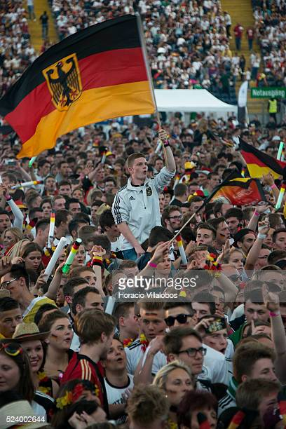 German fans cheer their team at the Commerzbank Arena in Frankfurt Germany 21 June 2014 while watching on a giant screen the GermanyGhana soccer...