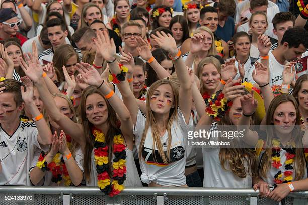 German fans cheer their team while watching on a giant screen GermanyFrance quarterfinals soccer match for the 2014 World Cup at the Commerzbank...