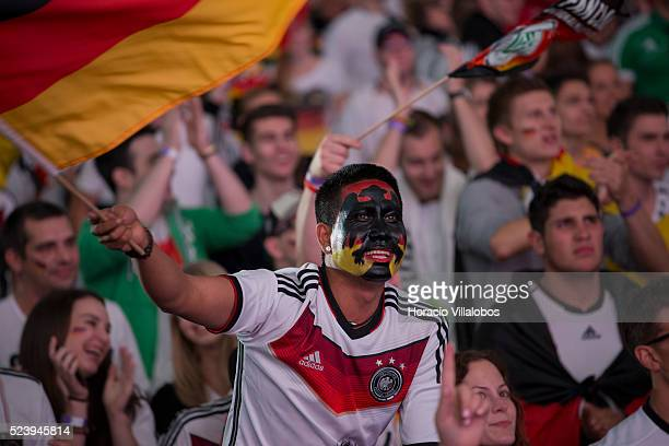 German fans cheer while watching on a giant screen Germany-Algeria soccer match at the 2014 World Cup at the Commerzbank Arena in Frankfurt, Germany,...