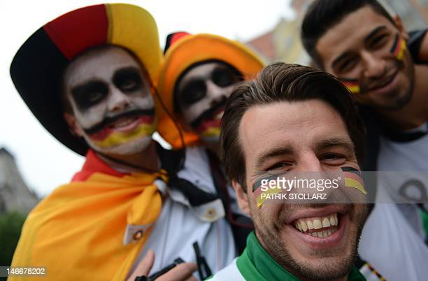 German fans pose Gdansk on June 22 2012 prior to the quarterfinal match between Greece and Germany during the Euro 2012 football championships...