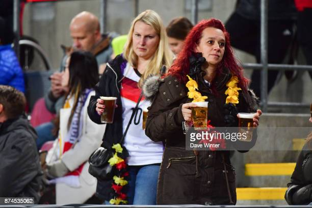 German fans taking beer to their seats during the international friendly match between Germany and France at RheinEnergieStadion on November 14 2017...