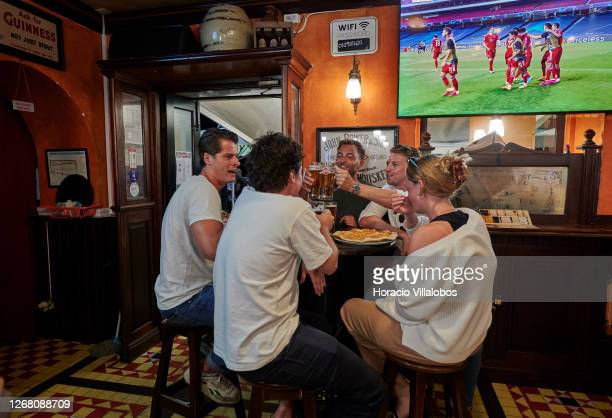 German fans toast in celebration the Bayern Munich goal while watching the UEFA Champions League Final match between Paris Saint-Germain and Bayern...