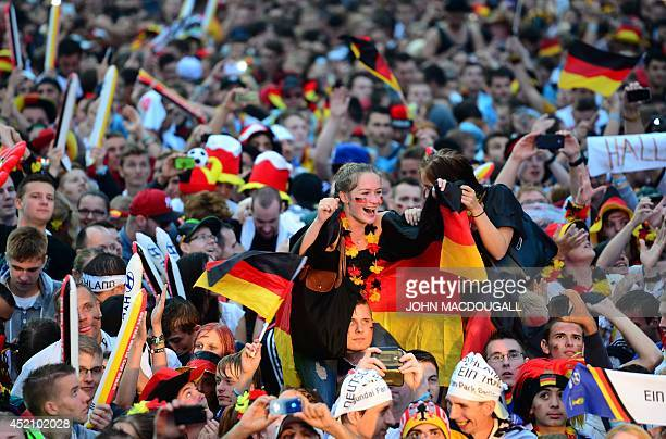 German fans watch the opening ceremony of the FIFA World Cup 2014 final football match Germany vs Argentina played in Brazil during an outdoor...