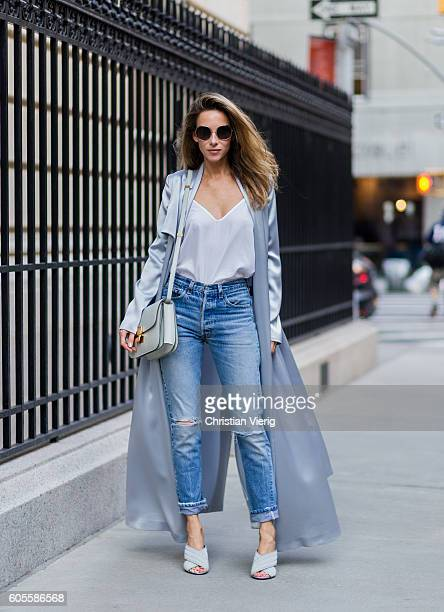 German fashion blogger and model Alexandra Lapp grey silk trench coat from Galvan Re Done Levis ripped denim jeans Gucci mules Celine bag Chloe...