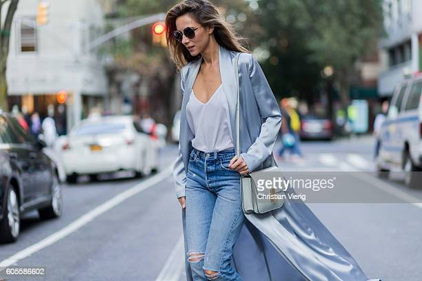 German fashion blogger and model Alexandra Lapp grey silk trench coat from Galvan Re Done Levis ripped denim jeans Celine bag Chloe sunglasses on...