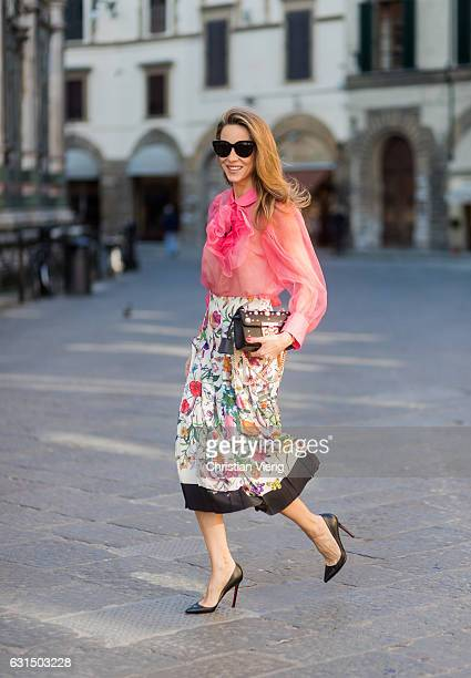German fashion blogger and model Alexandra Lapp is wearing a black Padlock shoulder bag by Gucci , a pink blouse by Gucci, pleated Flora snake, silk...