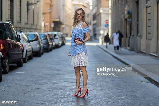 German fashion blogger and model Alexandra Lapp is wearing blue and white striped shirt dress with knotted arms and with white lace details from...