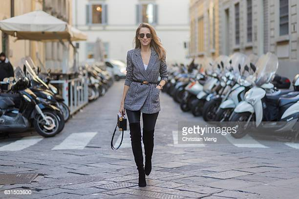 German fashion blogger and model Alexandra Lapp is wearing leather pants from Set suede overknee boots in black by Gianvito Rossi off white silk top...