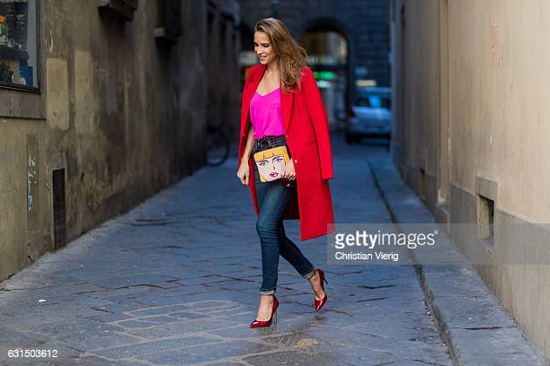 German fashion blogger and model Alexandra Lapp is wearing red coat from Oui Fashion pink silk top from Jadicted high waist jeans/denim from Rag Bone...