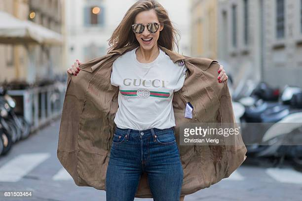 German fashion blogger and model Alexandra Lapp is wearing retro vibe Gucci printed cotton Tshirt featuring a throwback Gucci logo this piece...