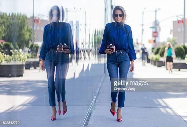 German Fashion Blogger and Model Alexandra Lapp wearing a blue blouse from Steffen Schraut, Levis jeans, Alexander Mc Queen clutch, Gianvitto Rossi...