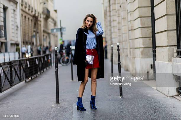 German fashion blogger and model Alexandra Lapp wearing a red skirt and button shirt from Zara blue Phillip Lim shoes Steffen Schraut black coat...