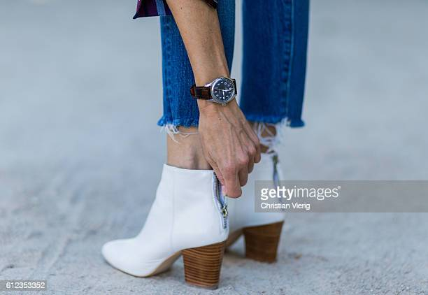 German fashion blogger and model Alexandra Lapp wearing an IWC watch Levis denim jeans white Zara shoes on October 3 2016 in Paris France