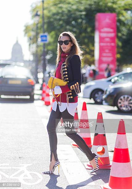 German fashion blogger and model Alexandra Lapp wearing black leather pants from SET Celine button shirt red sweater and jacket from Balmain...