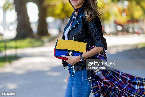 German fashion blogger and model Alexandra Lapp wearing Levis denim jeans a white James Perse tshirt L'Agence plaid dress Schott NYC leather jacket...