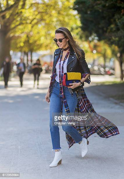 German fashion blogger and model Alexandra Lapp wearing Levis denim jeans a white James Perse tshirt L'Agence plaid dress white Zara shoes Ray Ban...