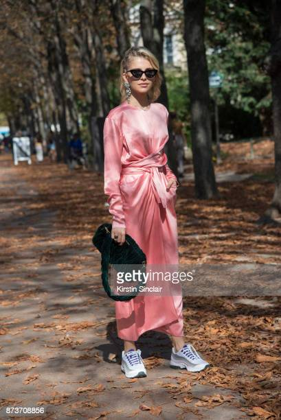 German fashion blogger Caroline Daur wears a Celine dress Le Specs sunglasses Nike trainers and a Miu Miu bag day 4 of Paris Womens Fashion Week...