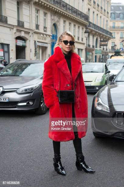 German fashion blogger Caroline Daur wears a Mango coat Ash boots OffWhite bag and trousers Le Specs sunglasses and Burberry earrings day 4 of Paris...