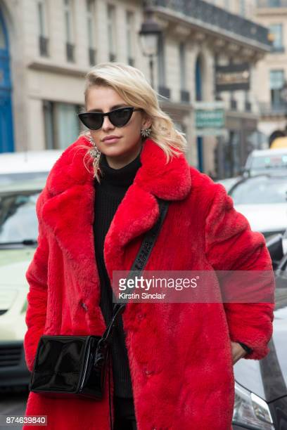 German fashion blogger Caroline Daur wears a Mango coat, Off-White bag, Le Specs sunglasses and Burberry earrings day 4 of Paris Womens Fashion Week...