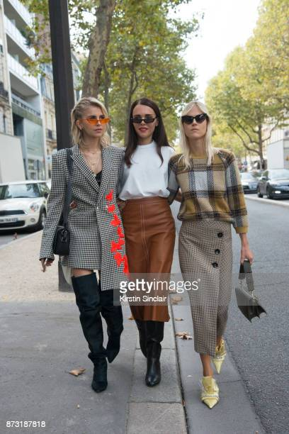 German fashion blogger Caroline Daur wears an OffWhite jacket and bag and Isabel Marant boots with Greek fashion blogger Evangelie Smyrniotaki from...