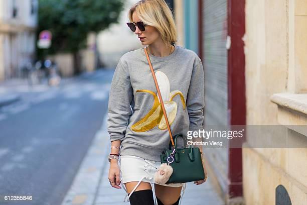 German fashion blogger Lisa Hahnbueck wearing Carly Banana Sweatshirt Acne Studios Isla Skirt Boots Overknee Boots Alllegs Stuart Weitzman Sunglasses...