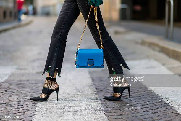 German fashion blogger Lisa Hahnbueck wearing dark black Storets Cropped Flare Jeans with Pearl Tassel Details Jimmy Choo Lockett Petite Bag in Blue...