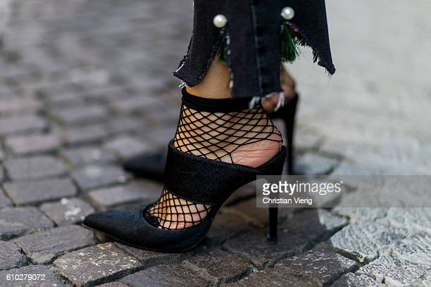 German fashion blogger Lisa Hahnbueck wearing dark black Storets Cropped Flare Jeans with Pearl Tassel Details Shoes Ueterque Asos Fishnet Ankle...