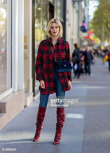 German fashion blogger Lisa Hahnbueck wearing Saint Laurent checked red Oversize Shirt JBrand Highwaist Jeans navy Chanel bag red Zara Overknees on...