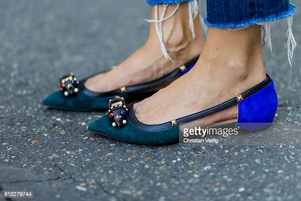 German fashion blogger Lisa Hahnbueck wearing shoes Christian Louboutin Style 'Tudor Young Veau Veloursâ during Milan Fashion Week Spring/Summer 2017...