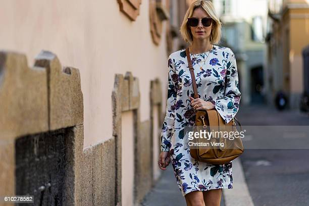German fashion blogger Lisa Hahnbueck wearing Silk Dress Flower Print Ganni Chloe Lexa Bag sunglasses Fendi during Milan Fashion Week Spring/Summer...