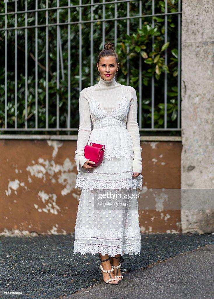 German fashion blogger Nina Schwichtenberg wearing a white dress from self-portrait, JW Anderson sweater, Patrizia Pepe bag, Paula Cadematori sandals outside Max Mara during Milan Fashion Week Spring/Summer 2017 on September 22, 2016 in Milan, Italy.