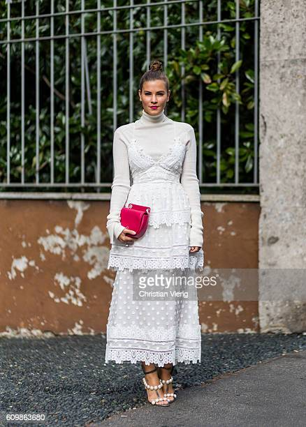 German fashion blogger Nina Schwichtenberg wearing a white dress from selfportrait JW Anderson sweater Patrizia Pepe bag Paula Cadematori sandals...