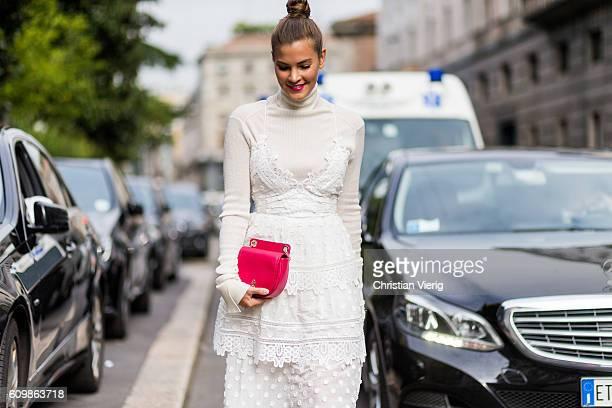 German fashion blogger Nina Schwichtenberg wearing a white dress from selfportrait JW Anderson sweater Patrizia Pepe bag outside Max Mara during...