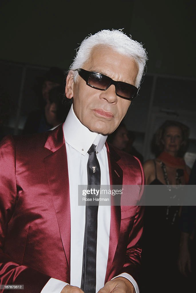 German fashion designer, artist and photographer Karl Lagerfeld at the Art Basel party being held at the Mynt Lounge, Miami, 2002.